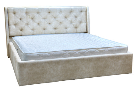 sprung: Wooden double bed with cream faux leather, and orthopedic mattresses. Stock Photo
