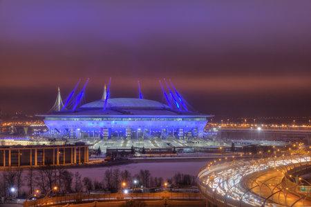 Saint-Petersburg, Russia - December 29, 2016: Western High-Speed Diameter in St. Petersburg near the football Zenith Arena stadium, FIFA World Cup in 2018 at night.