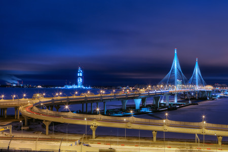 Saint-Petersburg, Russia - December 28, 2016: Cable-stayed bridge across the Petrovsky waterway as part of the Western High-Speed Diameter of St. Petersburg, illumination at night.