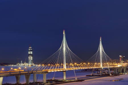 Saint-Petersburg, Russia - January 3, 2017: Night view of the headquarters of Gazprom, through the pylons of the cable-stayed bridge of the Western High Speed Diameter in St. Petersburg. Editorial