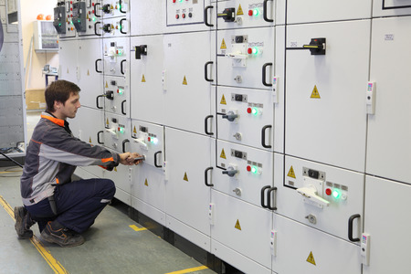 ingenieria elÉctrica: St. Petersburg, Russia - October 4, 2016: Electrical Engineer make Services, Testing and Maintenance Low voltage switchgear. Editorial