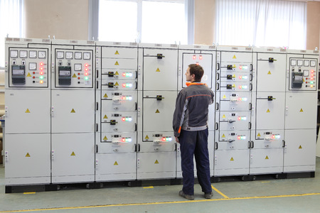 electromechanical: St. Petersburg, Russia - October 4, 2016: Engineer make Services electric transformer station or maintenance switchboard.