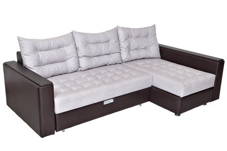 Corner convertible sofa bed with storage system, upholstery soft white fabric and armrests upholstered brown leatherette,  isolated on a white background, saved path selection. Stock Photo