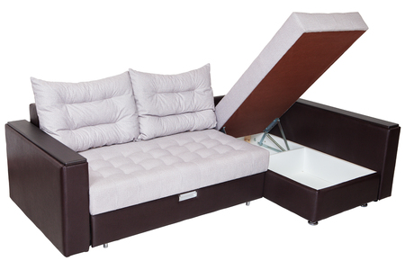 Corner convertible sofa-bed with storage space, upholstery soft white fabric and armrests upholstered brown faux leather,  isolated on a white background, saved path selection.