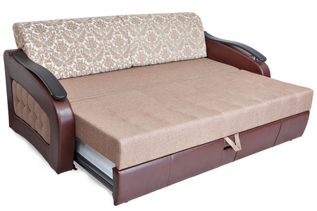 Queen-size pull out sofa-bed light brown fabric and storage space, isolated on white background, saved path selection.