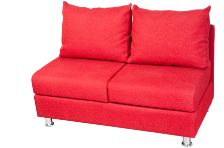 Two seater couch upholstered in red fabric, isolated on white, clipping path saved.