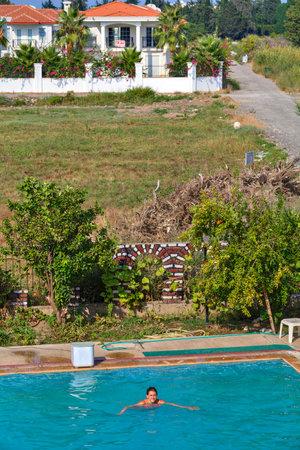 Camyuva, Kemer, Antalya, Turkey - 29 august, 2014: Top view of the outdoor swimming pool, where one girl swims.