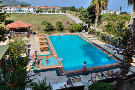 Camyuva, Kemer, Antalya, Turkey - 29 august, 2014: The guests of a small hotel, relax by the outdoor swimming pool.