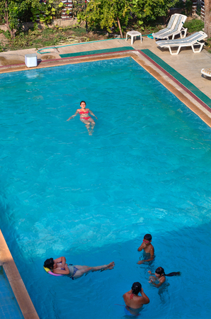 Camyuva, Kemer, Antalya, Turkey - 29 august, 2014: Guests at the resort, bathe in the outdoor swimming pool, view from above.