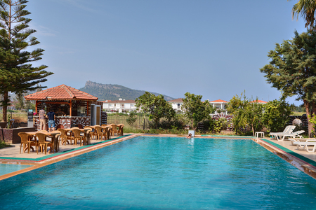 Camyuva, Kemer, Antalya, Turkey - 29 august, 2014: Swimming pool, barbecue area with bar in small hotel. Editorial