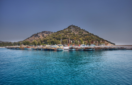 Antalya, Turkey - 28 august, 2014: A lot of excursion boats are moored at the shore in the harbor.