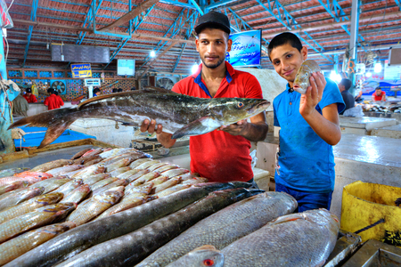 fish vendor: Bandar Abbas, Hormozgan Province, Iran - 15 april, 2017: Persian traders shows fresh fish at the indoor market.