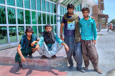 Bandar Abbas, Hormozgan Province, Iran - 16 april, 2017: A group of young Afghan men in an Iranian city. Editorial
