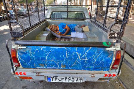 Bandar Abbas, Hormozgan Province, Iran - 16 april, 2017: Iranian worker sleeps in a truck on the street