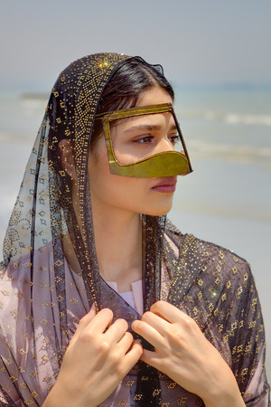 Portrait of a Persian girl in a traditional Muslim mask of southern Iran. 版權商用圖片