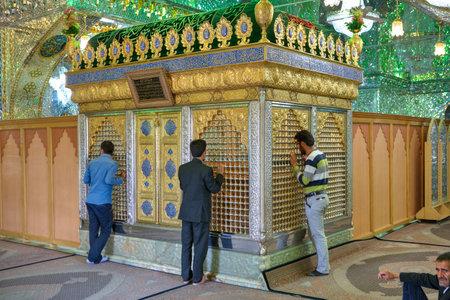 Fars Province, Shiraz, Iran - 18 april, 2017:  Mirrored mausoleum in  Sayyed Alaeddin Hossein Mosque, Iranian men worship an Islamic shrine.