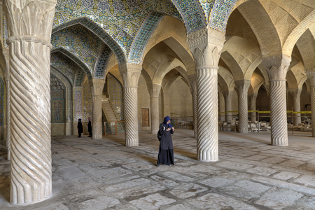 Fars Province, Shiraz, Iran - 19 april, 2017: The tourist attraction of the Iranian city of Shiraz, Vakil mosque, vaulted ceilings and monolithic carved columns of prayer hall are visited by tourists.