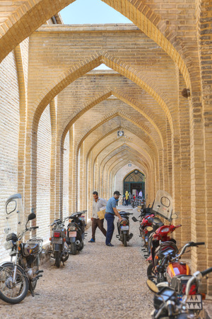 Fars Province, Shiraz, Iran - 19 april, 2017: Arched street adjoining Vakil bazaar with Parking places for motorbikes.
