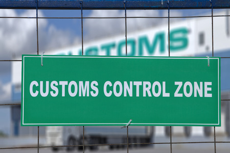 Logistics complex behind the green sign, customs control zone.