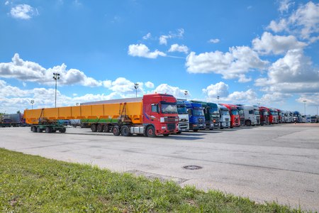 St. Petersburg, Russia - July 27, 2017: Fleet of trucks, a lot of trucks parked in the yard of a logistics park. Editorial
