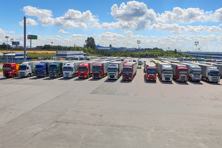 St. Petersburg, Russia - July 27, 2017: Truck fleet of trucks, a lot of trucks parked in the courtyard of the logistics park. Reklamní fotografie - 90558751