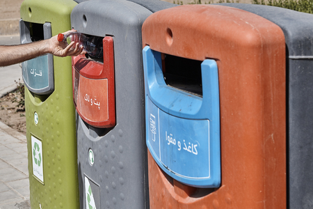 Three wheelie bins in three different colours used for separated waste situated Yazd, Iran.