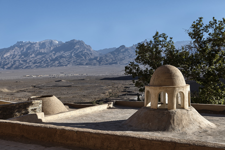 Zoroastrian building on the background of a mountain ridge, near the town of Yazd in Iran.
