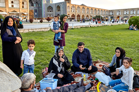 Isfahan, Iran - April 23, 2017: Iranian family make picnicking in the Naghshe Jahan square.