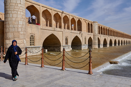 Isfahan, Iran - April 24, 2017: View of the ancient bridge Allahverdi Khan across the river Zayandeh.