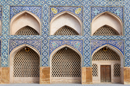 Isfahan, Iran - Arches in the mosaic wall in the Iranian Jame Mosque. Stock Photo