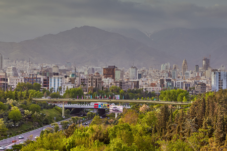 Tehran, Iran - April 28, 2017: The urban landscape of northern Tehran with the Bridge of Water and fire or Abo Atash bridge and Alborz Mountains. Editorial