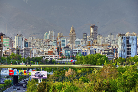 Tehran, Iran - April 28, 2017: Cityscape of northern Tehran with the Bridge of Water and fire or Abo Atash bridge and Alborz Mountains. Editorial