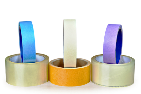 Six rolls of tape different color and various use purposes isolated on white background with saved clipping path. Stock Photo