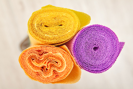Top view of three rolls of colored corrugated paper for creativity and craft.