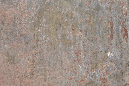 Metal surface with discoloration cracked paint, abstract texture for backdrop.