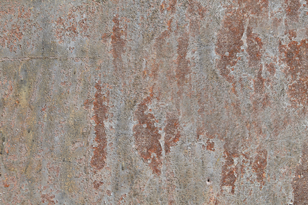 Old steel wall with discoloration cracked paint and corrosion , abstract texture for background.