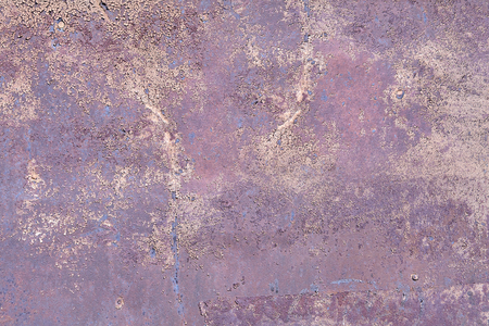 Surface of shabby metal wall with flaked lilac paint, abstract texture for background.