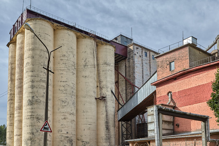 Vitebsk, Belarus - July 7, 2018: Bucket Elevators is used to store food, feed and other granular or powdered materials. 新聞圖片