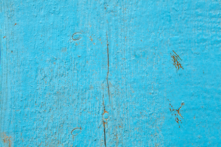 Old shabby wooden board, painted in light blue color,  texture surface for background. Stock Photo