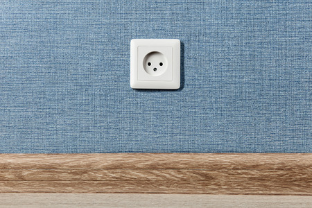 Euro electric outlet type C, electrical point of power in house, on the blue wall background. Stok Fotoğraf - 124464451