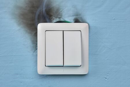 The electric light switch began to smoke. Electrical fires are one of the most common fire hazards at homes.