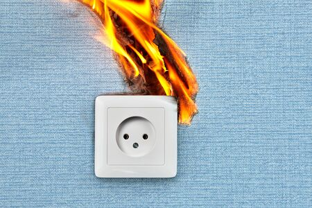 Bad electrical wiring blames in case of fire electric outlet. Faulty wiring causes fires.