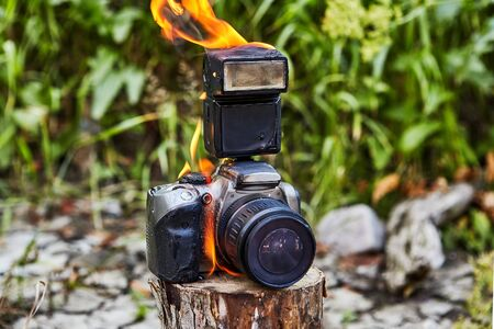 Wildfire destroyed the tourists camera. Tourists  forgot a camera on a stump. Fire destroyed the camera. The gadget was burned, melted, and failed, it is faulty and unsuitable for photography.