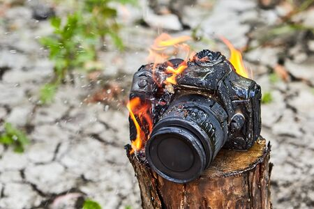 The fire melted and charred camera body, burnt camera inoperable. Bad luck during a camping trip. Forest fire destroyed the photographers property, the camera burned down.