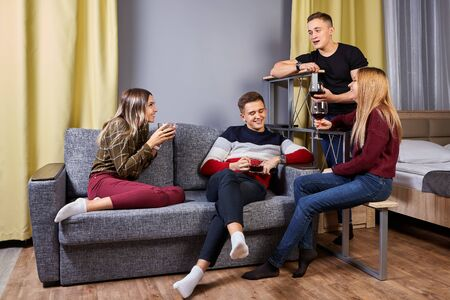 Two couples in love met in an apartment for a double romantic date. Stock Photo
