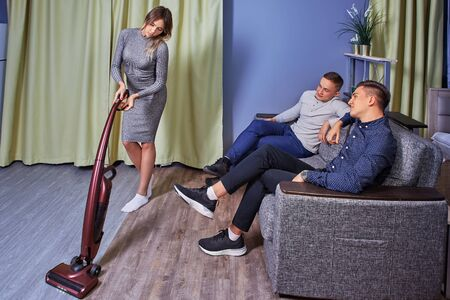 Sex discrimination, employers discuss the figure of a slender cleaning lady.