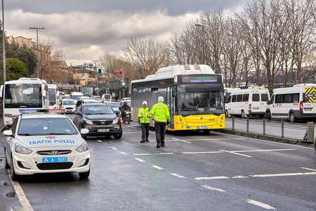 Istanbul, Turkey - February 12, 2020: Traffic police control vehicles on a busy highway.