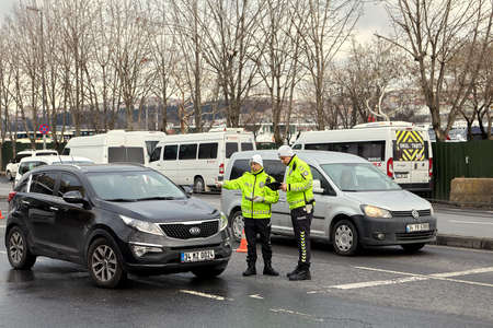 Istanbul, Turkey - February 12, 2020: Traffic police checks documents with drivers of vehicles.