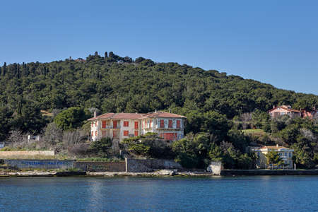 Istanbul, Turkey - February 13, 2020: An abandoned summer cottage with boarded up windows stands on a hillside, on the shores of the Sea of Marmara on either of the Prince's Islands or Kzl Adalar. Sajtókép