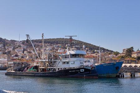 Istanbul, Turkey - February 13, 2020: Princes' Islands or Kzl Adalar in Marmara Sea, fishing trawler moored at the pier of the island of Heybeliada.